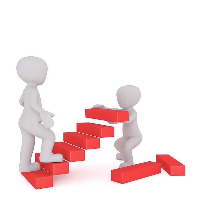 Dve postavičky stavajú schody.jpg